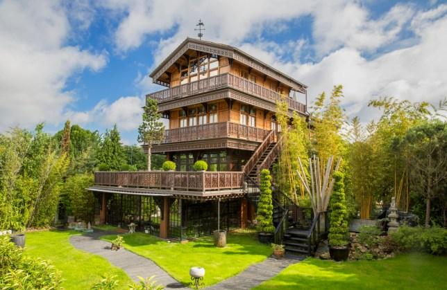 This £2.8 million house has an indoor beach with underfloor heating, massage beds, and a samurai sword bridge