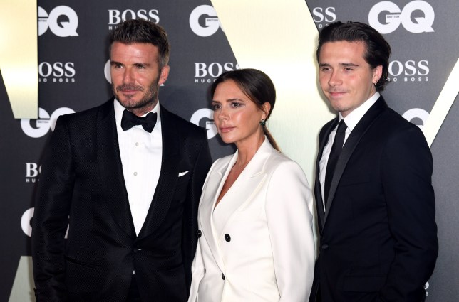 David Beckham, Victoria Beckham and Brooklyn Beckham at the GQ Men of the Year Awards 2019 in association with Hugo Boss held at the Tate Modern, Bankside, London.