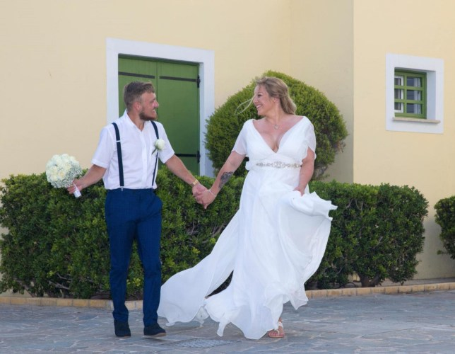 Hannah and Joe Webb on their wedding day, with Hannah wearing a £650 wedding dress