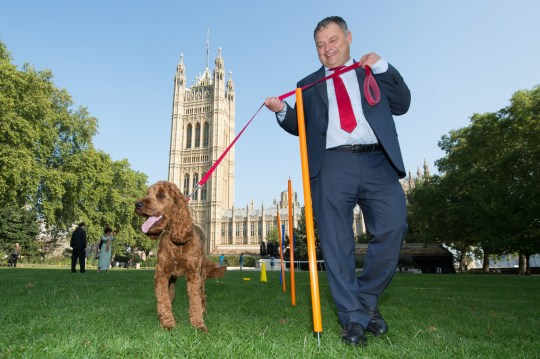 EDITORIAL USE ONLY Mike Amesbury MP with Cockapoo, Corbyn, winner of the Pawblic Vote award during the 26th annual Westminster Dog of the Year competition, which was won by Boomer and Corona, belonging to Alex Norris MP. The competition is organised jointly by Dogs Trust and The Kennel Club at Victoria Tower Gardens, Westminster.