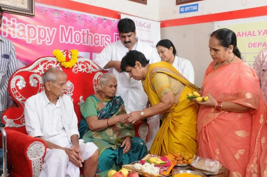 Erramatti Mangayamma and her husband Rajarao (seated right) pose pictured at their baby shower after they became the oldest parents of newborns in the world. See SWNS story SWOCtwins. A 74-year-old Indian woman has become the oldest mum in the world - after giving birth to TWINS. Erramatti Mangayamma has waited 60 YEARS to have children with her 80-year-old husband, Rajarao, a farmer. But she is now the proud mother of twins after undergoing IVF. Erramatti, from the small Nelapartipadu village in the Eastern Godavari district of India, was given the all clear for IVF treatment at the Ahalya Hospital last year.