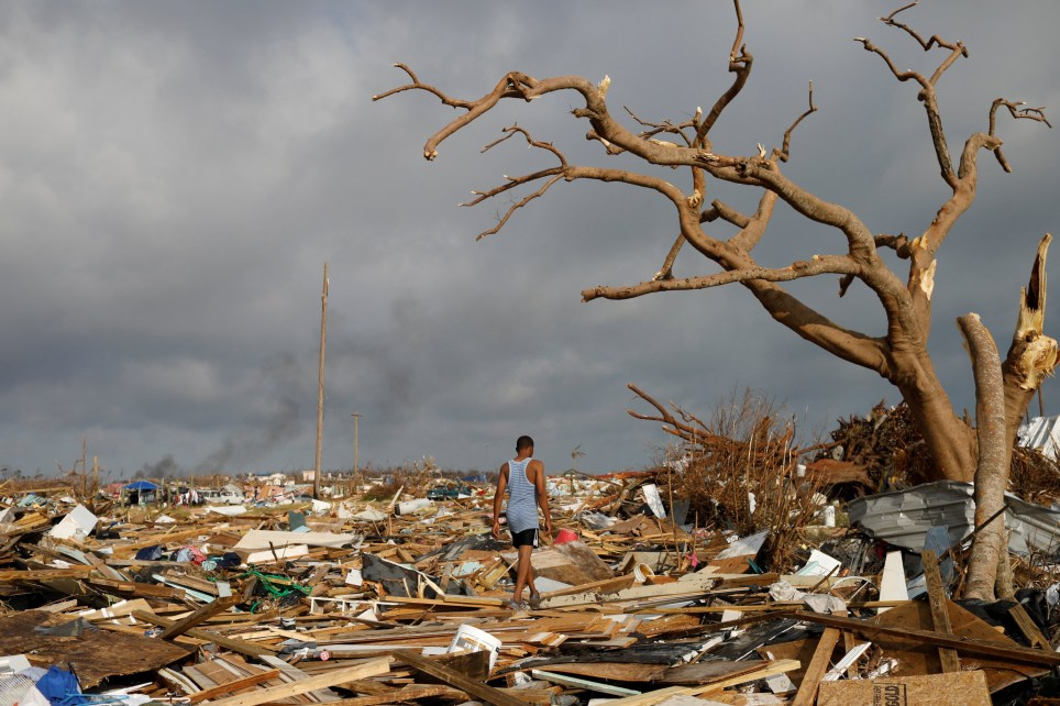 A man walks among debris at the Mudd neighborhood, devastated after Hurricane Dorian hit the Abaco Islands in Marsh Harbour, Bahamas, September 6, 2019. REUTERS/Marco Bello TPX IMAGES OF THE DAY