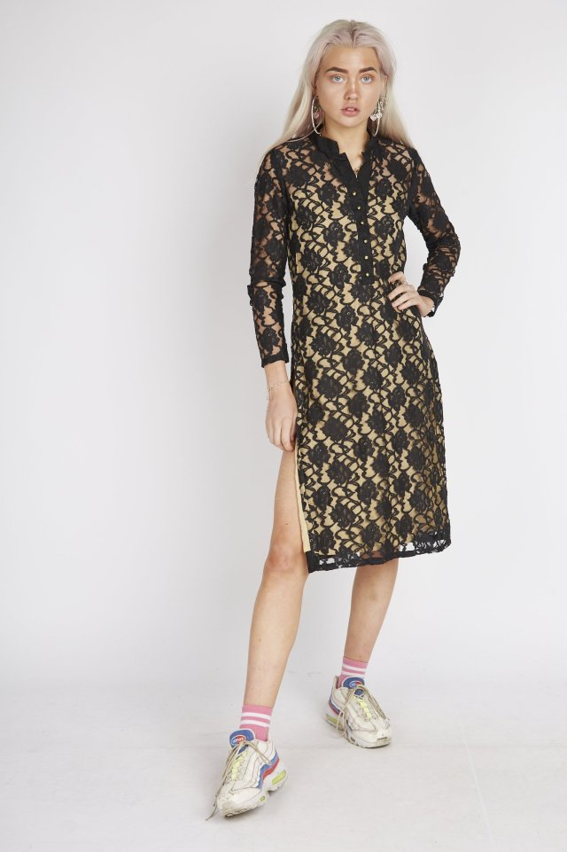 White woman wearing an old south Asian kameez without trousers