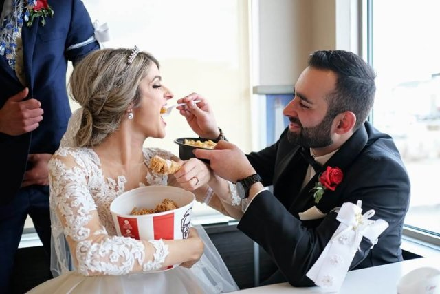 groom feeds bride kfc on wedding day
