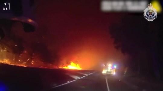 Queensland police ride through bushfires to conduct evacuation Picture: Queensland Police METROGRAB