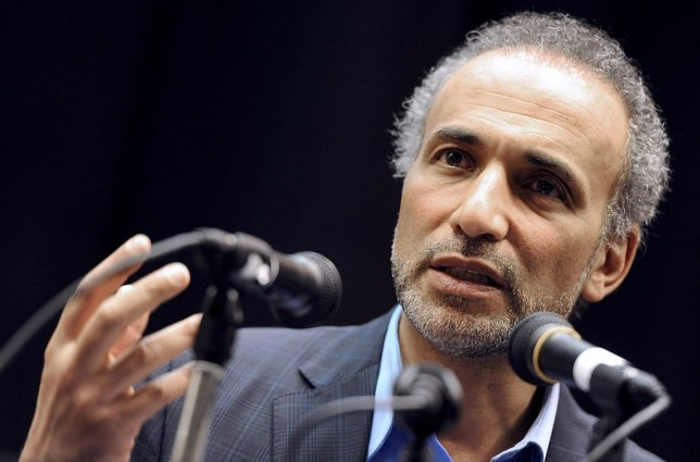 "Swiss Muslim intellectual and professor, Tariq Ramadan, speaks on March 4, 2012 during a conference focused on ""Muslims of France and the electoral speculation"" in Nanterre, in the western suburbs of Paris. Tariq Ramadan condemned today comments of French Interior Minister Claude Gueant, a hardliner close to President Nicolas Sarkozy, who said on March 2, 2012 'racist' remarks for the second time in a month. His latest comments came as the FN's presidential candidate Marine Le Pen is credited with between 16 and 20 percent support in opinion polls. AFP PHOTO / MEHDI FEDOUACH (Photo credit should read MEHDI FEDOUACH/AFP/Getty Images)"