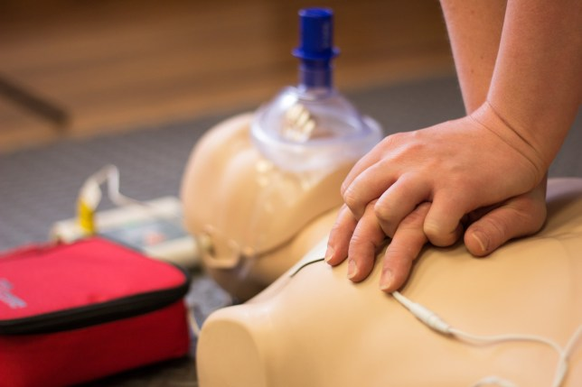 CPR demonstration on manikin.