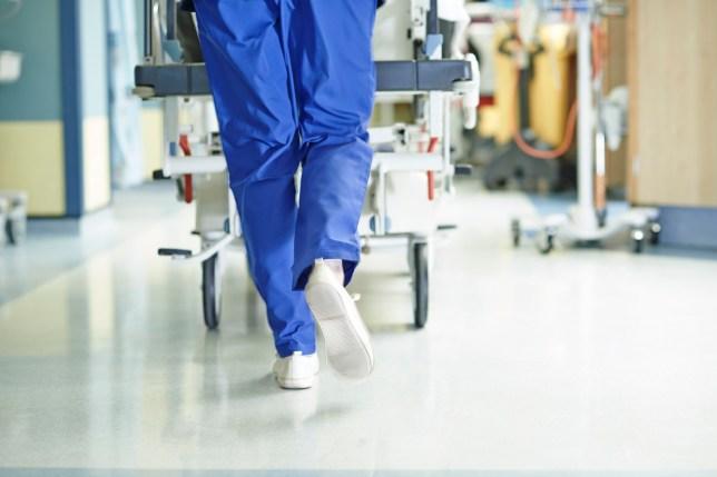 Doctor running in corridor