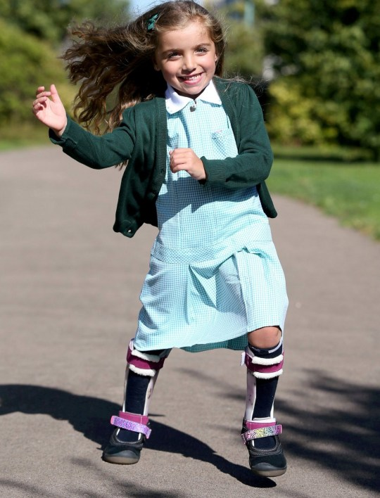"""Lilac Jackson, 4, at home in Cheltenham.September 12 2019. Incredible Lilac Jackson, who has cerebral palsy, has enchanted the nation after a video of her walking into her first day at school went viral. See SWNS story SWBRlilac.This incredibly moving video shows an adorable little girl with cerebral palsy beating all the odds - to walk into school unaided on her first day. Little Lilac Jackson, who is almost five, has spastic diplegia cerebral palsy, and has always relied on walking aids to move about. But her emotional parents Leila, 37, and Barry, 39, watched in amazement as their little girl walked into her classroom for her first day of primary school on Monday - without any help. And Leila said Lilac has been """"blowing her teacher's minds"""" during her first week at Woodmancote Primary School in Cheltenham, Glos., as she potters around her classroom unaided."""