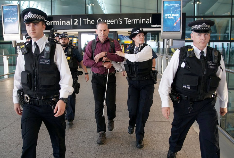 Irish Paralympian James Brown of Heathrow Pause, a splinter group of Extinction Rebellion, hands himself in to police at Heathrow Terminal 3, London. 13 September 2019
