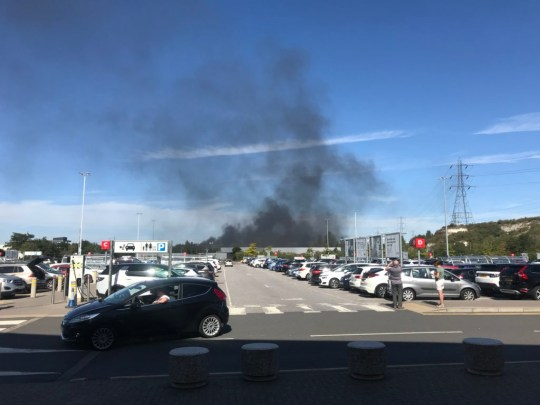 Car fire at Lakeside with large plumes of smoke billowing above shopping centre