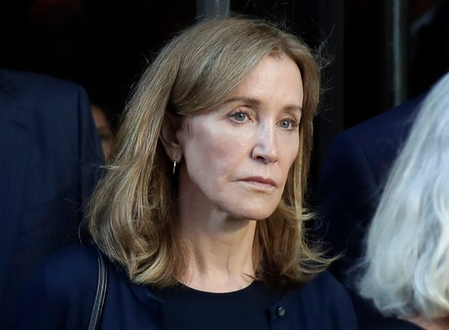 Desperate Housewives' Felicity Huffman turns herself in to begin 14-day sentence over college admissions scandal