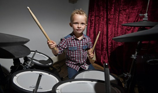 Caleb Hayes, four from Silloth. A four-year-old boy wowed crowds at Solfest when he opened the Sunday set drumming to rock songs. See SWNS story SWLEdrummer. Caleb Hayes who lives in Silloth with mum Kim, dad Andrew and seven-year-old sister Isabelle, has been drumming since he was two. He started to show an interest when he was just one. Caleb???s parents are both musicians and his dad is a drummer which piqued his interest. Kim said: ???He started playing with a pencil. Then he started using Andrew???s sticks and he???d use anything - cushions mainly. ???But when he got to two he started playing on Andrew???s drums and that???s when we realised he???s got some tunes so we brought him his own electric drums. ???He started properly playing at two but he???d shown an interest earlier.??? Caleb is constantly playing on his drums and has a Roland drumming set which his parents say is helping him to learn and his skills to grow.