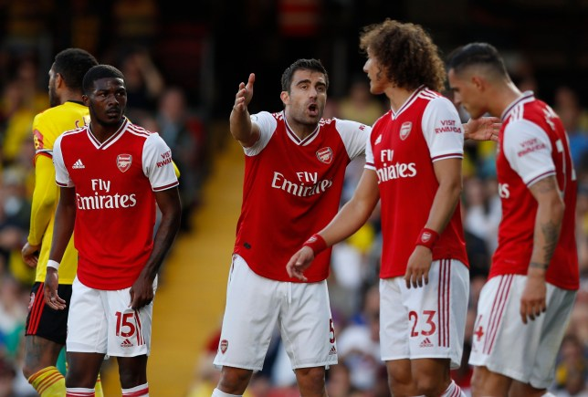 Sokratis Papastathopolous gestures to David Luiz in Arsenals 2-2 draw against Watford