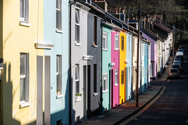 Spring-like sunshine brightens colourful terraced housing in Brighton, England.