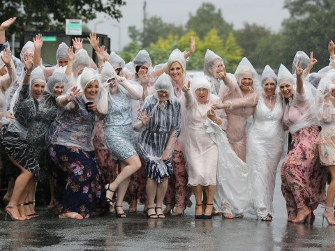 Bride and groom rock ponchos as they refuse to let the rain ruin their big day