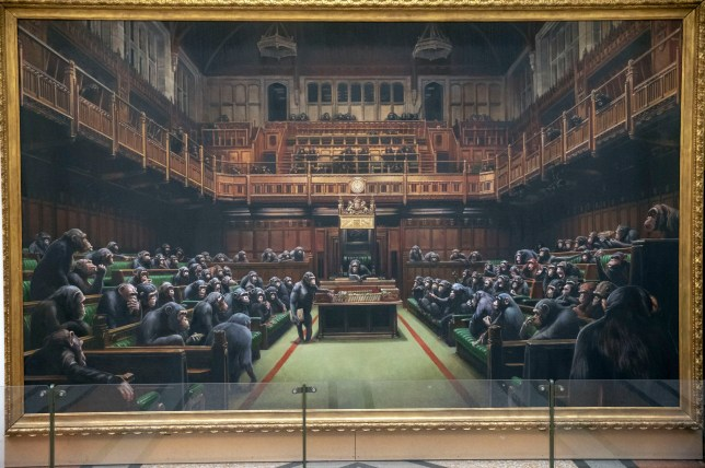 The painting 'Devolved Parliament' by the graffiti artist Banksy, which is going up for auction.