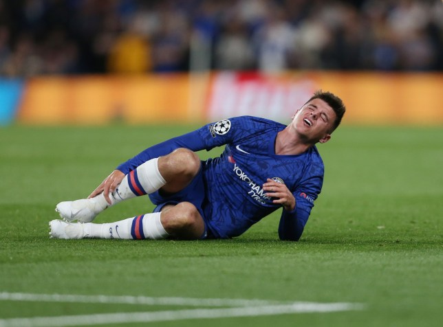 Chelsea's Mason Mount looks in pain after a first half challenge during the UEFA Champions League group H match between Chelsea FC and Valencia