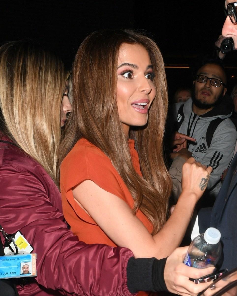Cheryl leaving the Dominion Theatre in London