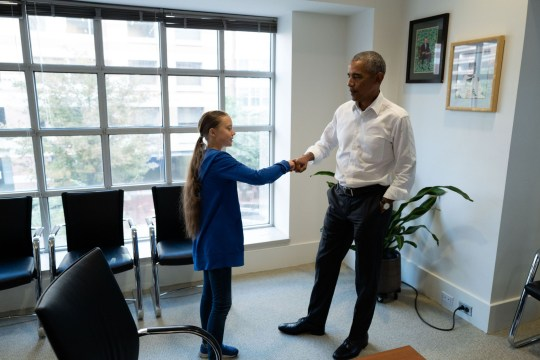 """TOPSHOT - Former US President Barack Obama (R) meets with Swedish Environmental activist Greta Thunberg at the Obama Foundation headquarter in Washington DC on September 16, 2019. - Thunberg will attend the Youth Climate Summit at the UN in New York on September 21, followed by the UN Climate Action Summit on September 23 convened by the Secretary-General Antonio Guterres to find ways for countries to reduce their greenhouse gas emissions in line with the Paris Agreement. (Photo by - / various sources / AFP) / RESTRICTED TO EDITORIAL USE - MANDATORY CREDIT """"AFP PHOTO / THE OBAMA FOUNDATION"""" - NO MARKETING - NO ADVERTISING CAMPAIGNS - DISTRIBUTED AS A SERVICE TO CLIENTS-/AFP/Getty Images"""