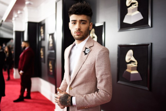 NEW YORK, NY - JANUARY 28: Recording artist Zayn Malik, white rose detail, attends the 60th Annual GRAMMY Awards at Madison Square Garden on January 28, 2018 in New York City. (Photo by Kevin Mazur/Getty Images for NARAS)