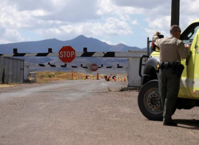 Law enforcement guard the entrance to Area 51