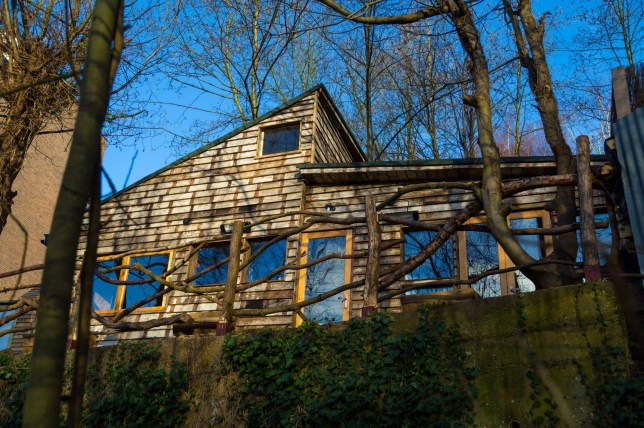 An illegally constructed home nestles among the trees at the edge of Hampstead Heath. See National News story Nnchalet. An artist who built a luxury waterfront shack on Hampstead Heath without planning permission has been told she has four months to tear it down. Jita Lukka, 57, built the chalet from recycled materials including scaffolding planks, pallet crates and discarded caravans in 2017 after buying the picturesque plot of land in the Vale of Health for ??700,000. But last year Camden Council issued a notice that claiming that Bren Cottage - named after Jita???s pet dog - had been built illegally, following complaints from neighbours in the exclusive north London enclave. Bren Cottage is in a hollow of houses once home to novelist and writer D.H. Lawrence and newspaper founder and magnate Lord Northcliffe, and more recently former Oasis frontman Liam Gallagher.