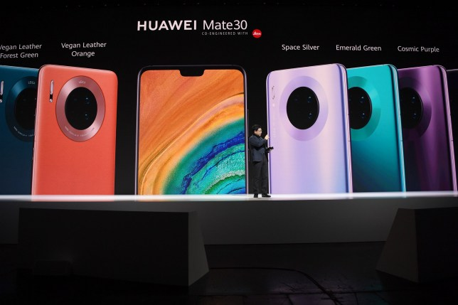 (190919) -- MUNICH, Sept. 19, 2019 (Xinhua) -- Richard Yu, CEO of Huawei Consumer Business Group, introduces Huawei's Mate 30 Series to guests at a press conference in Munich, Germany, Sept. 19, 2019. China's telecom giant Huawei unveiled its Mate 30 Series, the world's first second generation 5G smartphone, here on Thursday. (Xinhua/Lu Yang)
