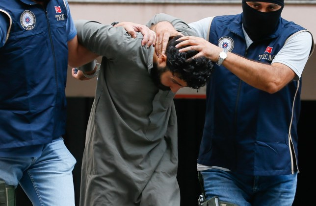 Police officers escort suspected Daesh member Muhammed Ramadan who is claimed to be in execution team of the terrorist group after he was held in Turkey's western Izmir