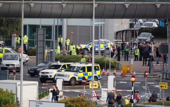 Police officers are seen as a suspect package was found at Manchester Airport, in Manchester, Britain September 23, 2019. REUTERS/Phil Noble