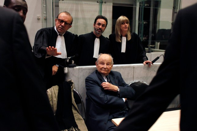 FILE - In this May 21, 2013 file photo, Jacques Servier, founder of Servier Laboratories, sits during the opening of the trial of the so-called Mediator case, a drug linked to hundreds of deaths, at Nanterre's court house, outside Paris. A massive trial with more than 4,000 plaintiffs is opening for French pharmaceutical giant Servier Laboratoires and France's medicines watchdog, accused of involuntary manslaughter, fraud and other charges in a scandal over a diabetes medication suspected of causing hundreds of deaths. (AP Photo/Thibault Camus, File)