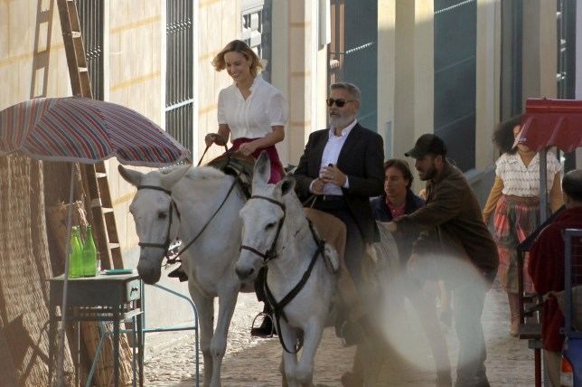 epa07868394 A handout photo made available by the Town Hall of Navalcarnero shows US actor George Clooney (C) and US actress Brie Larson (L) riding a horse during the filming of a commercial ad in Navalcarnero, near Madrid, Spain, 25 September 2019. EPA/HANDOUT HANDOUT EDITORIAL USE ONLY/NO SALES