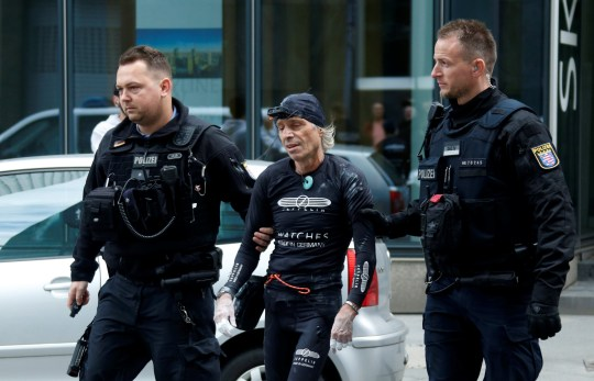 """French urban climber Alain Robert, also known as """"The French Spiderman"""", is escorted by German police after he climbed the Skyper building in Frankfurt, Germany, September 28, 2019. REUTERS/Ralph Orlowski"""