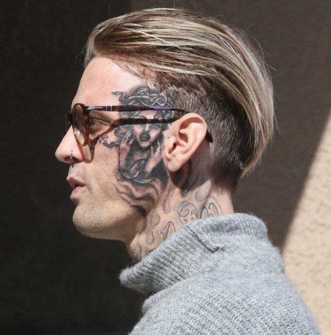 Los Angeles, CA - Aaron Carter shows off his new face tattoo while out running errands in Los Angeles. The troubled singer picked up flowers and a pumpkin from the market, then hit up Guitar Center to pick up a few musical instruments before taking his new motorcycle out for a spin. Pictured: Aaron Carter BACKGRID USA 29 SEPTEMBER 2019 USA: +1 310 798 9111 / usasales@backgrid.com UK: +44 208 344 2007 / uksales@backgrid.com *UK Clients - Pictures Containing Children Please Pixelate Face Prior To Publication*