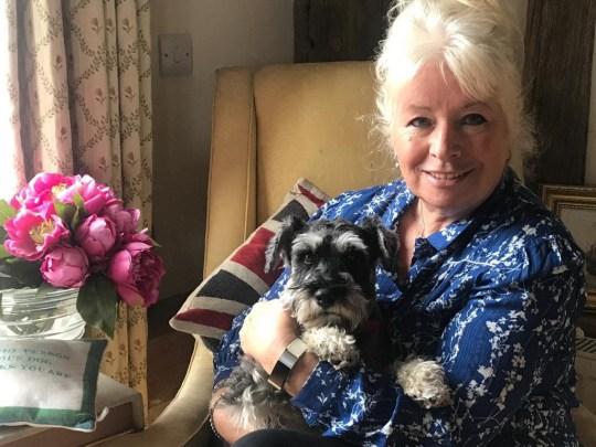 Debbie Matthews and her miniature schnauzer named Pepper
