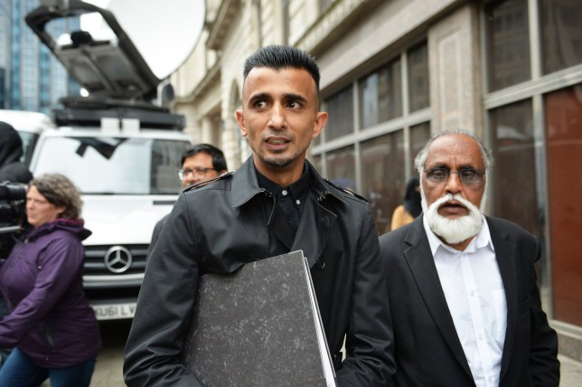 Shakeel Afsar (centre) outside the Priory Law Courts in Birmingham during a hearing to reconsider an injunction prohibiting anti-LGBT lessons protesters from being in the immediate surroundings of Anderton Park Primary School. PRESS ASSOCIATION Photo. Picture date: Monday June 10, 2019. Protesters - who face arrest if they break the order - will have a chance to put their case to the judge during a hearing at Birmingham Civil Justice Centre. See PA story EDUCATION Anderton. Photo credit should read: Jacob King/PA Wire