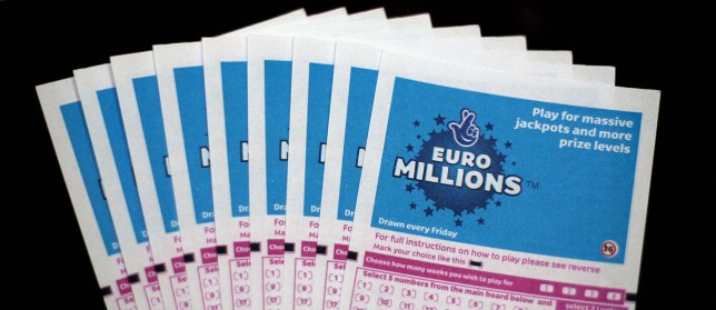 Lottery tickets for the EuroMillions jackpot are displayed in central London, on February 8, 2008. Lottery history could be made later Friday in the EuroMillions draw. The 95m (approx 127.6m euros/185m USD) prize will be the biggest pay-out of its kind in the world if it is won by a single ticket holder. AFP PHOTO/SHAUN CURRY (Photo credit should read SHAUN CURRY/AFP/Getty Images)