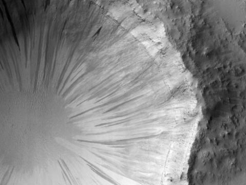 Nasa spots strange alien 'dandelion clock' crater on the surface of Mars