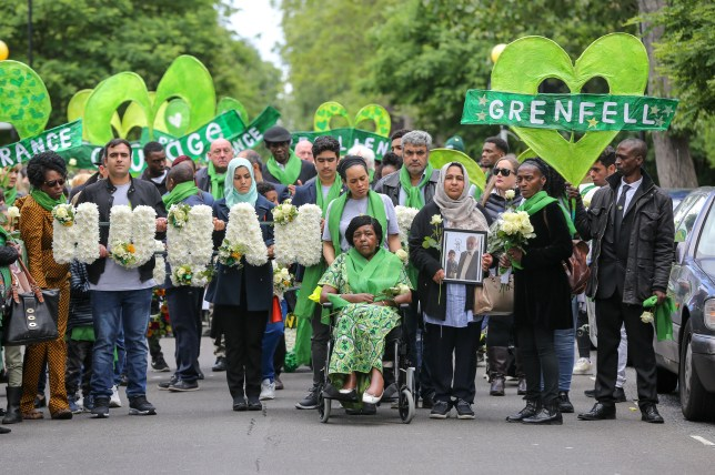 Survivors, family and friends of the Grenfell Tower fire in a silent march in June, 2019