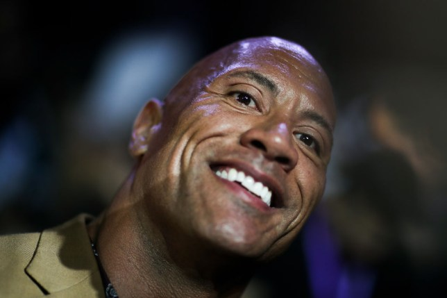 Dwayne 'The Rock' Johnson smiles at a press conference for his latest film