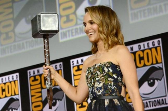 Natalie Portman with Thors hammer