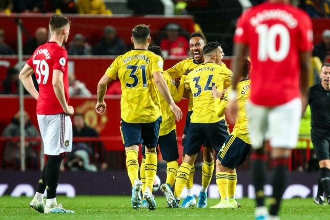 MANCHESTER, ENGLAND - SEPTEMBER 30: Pierre-Emerick Aubameyang of Arsenal celebrates after scoring a goal to make it 1-1 during the Premier League match between Manchester United and Arsenal FC at Old Trafford on September 30, 2019 in Manchester, United Kingdom. (Photo by Robbie Jay Barratt - AMA/Getty Images)
