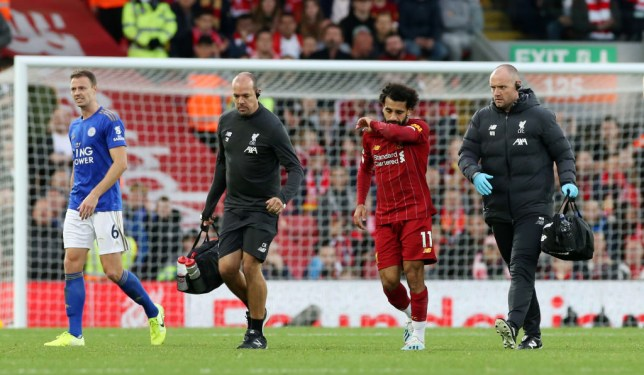 LIVERPOOL, ENGLAND - OCTOBER 05: Mohamed Salah of Liverpool goes off to receive treatment during the Premier League match between Liverpool FC and Leicester City at Anfield on October 5, 2019 in Liverpool, United Kingdom. (Photo by Plumb Images/Leicester City FC via Getty Images)