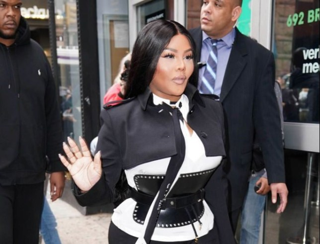 Lil Kim tells animal rights protester to 'back up' as they yell at her to stop wearing fur