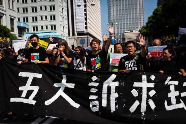Demonstrators protesting in Tsim Sha Tsui district of Hong Kong