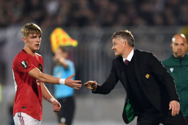 Ole Gunnar Solskjaer shakes the hand of Brandon Williams as he is substituted