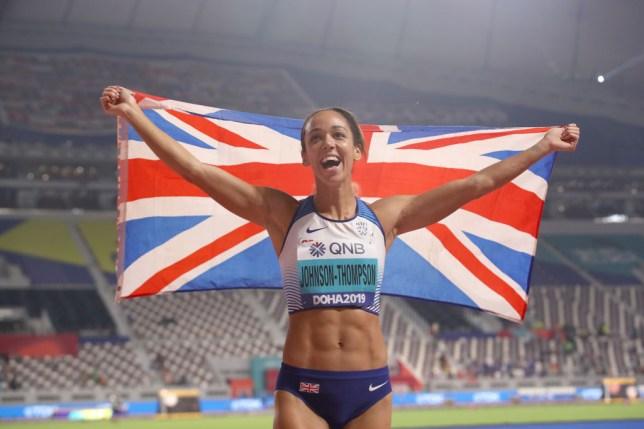 Katarina Johnson-Thompson celebrates winning gold at the World Athletics Championships Doha
