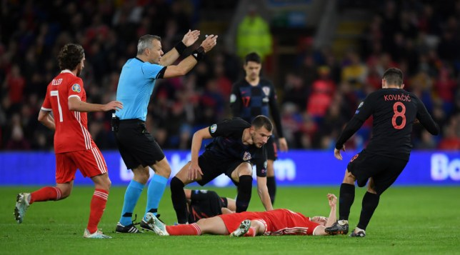 CARDIFF, WALES - OCTOBER 13: Daniel James of Wales lies on the ground after colliding with Borna Barisic of Croatia during the UEFA Euro 2020 qualifier between Wales and Croatia at Cardiff City Stadium on October 13, 2019 in Cardiff, Wales. (Photo by Alex Davidson/Getty Images)