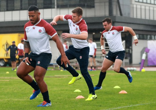 TOKYO, JAPAN - OCTOBER 22: Owen Farrell (C) warms up with team mate George Ford (R) and Manu Tuilagi during the England training session held at Arcs Urayasu Park on October 22, 2019 in Tokyo, Japan. (Photo by David Rogers/Getty Images)