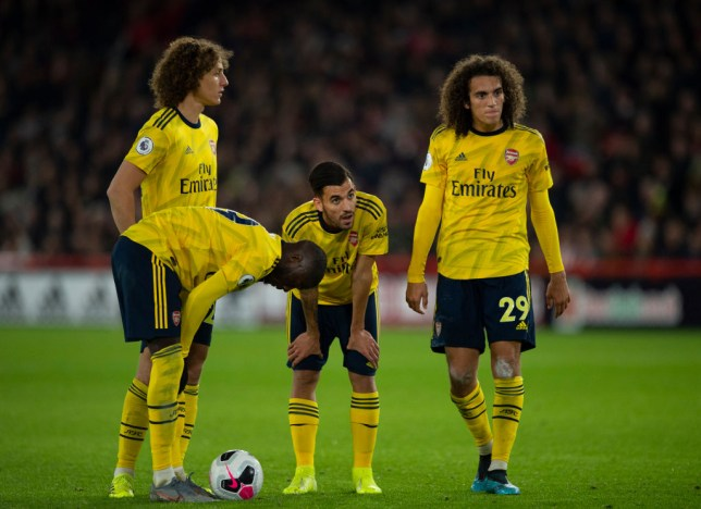 Arsenal players look despondent during their defeat to Sheffield United